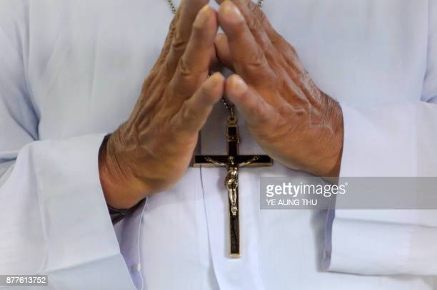 This photo taken on November 17 2017 shows a father praying during a jubilee celebration marking the anniversary of when they entered or professed...