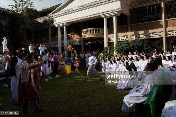 This photo taken on November 17 2017 shows nuns and people taking part in a jubilee celebration marking the anniversary of when they entered or...