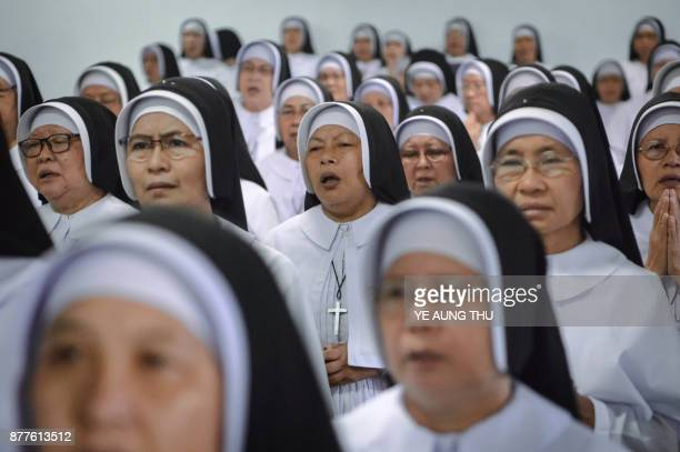 This photo taken on November 17 2017 shows nuns praying during a Jubilee celebration marking the anniversary of when they entered or professed vows...