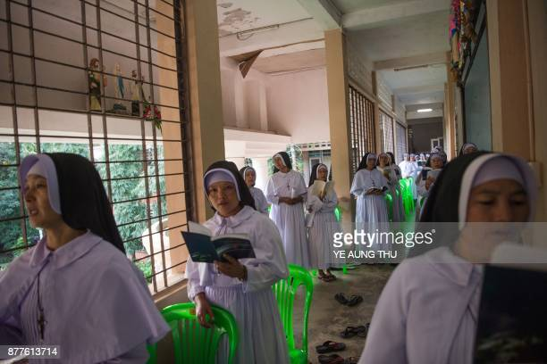 This photo taken on November 17 2017 shows nuns reading prayer books during a jubilee celebration marking the anniversary of when they entered or...