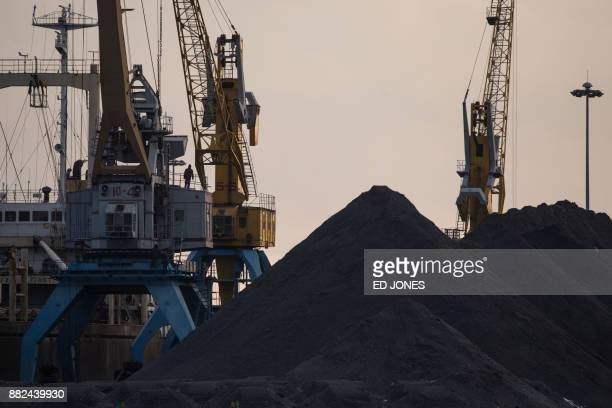 This photo taken on November 21 2017 shows a general view of North Korean coal piled up on a dockside at the port in Rason At the northeastern tip of...
