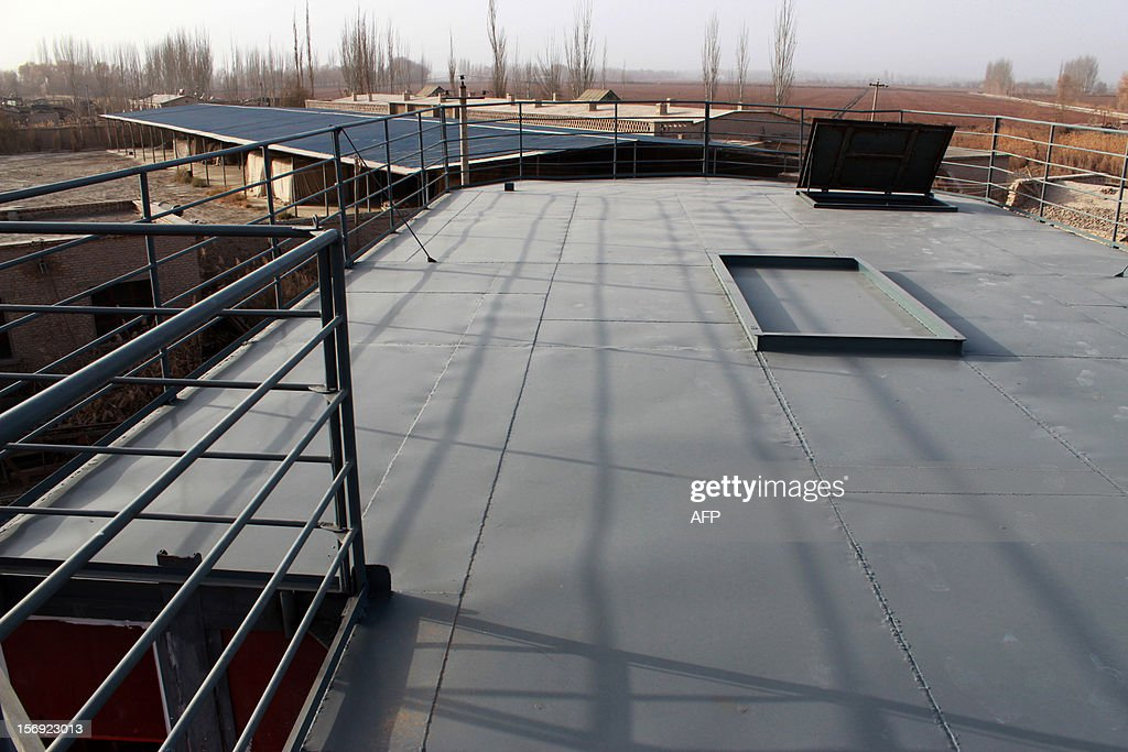 This photo taken on November 24, 2012 shows the roof of the unfinished boat built by Lu Zhenhai, a man from Urumqi, Xinjiang Uyghur Autonomous Region, afraid that his home would be submerged in a doomsday flood in 2012. Lu said he was worried that the apocalypse would happen in 2012, so he decided to invest all his money, about 160,500 USD into building what he hopes will be his own indestructible ark. CHINA