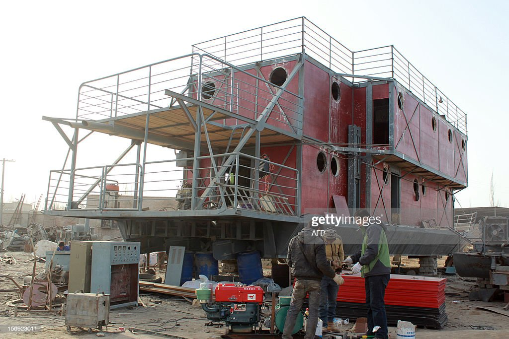 This photo taken on November 24, 2012 shows the unfinished boat built by Lu Zhenhai, a man from Urumqi, Xinjiang Uyghur Autonomous Region, afraid that his home would be submerged in a doomsday flood in 2012. Lu said he was worried that the apocalypse would happen in 2012, so he decided to invest all his money, about 160,500 USD into building what he hopes will be his own indestructible ark. CHINA
