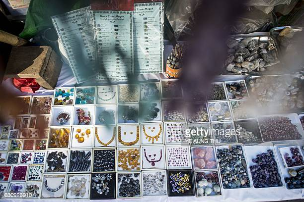 This photo taken on November 25 2016 shows gems being displayed at the gem market in Mogok north of Mandalay Myanmar produces more than 80 percent of...