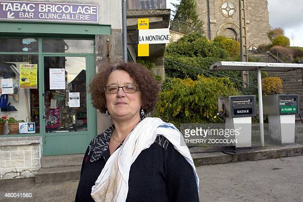 This photo taken on November 27 2014 shows gasoline retailer Corinne Douhet Gatignola posing by her gas station in SaintGenesChampespe central France...
