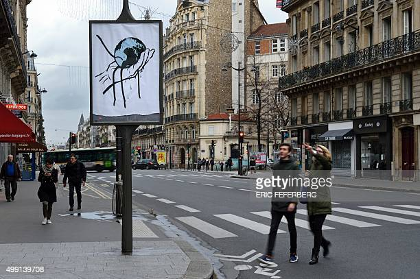 This photo taken on November 29 2015 in Paris shows artwork on a city billboard space denouncing the multinational corporate control of climate...