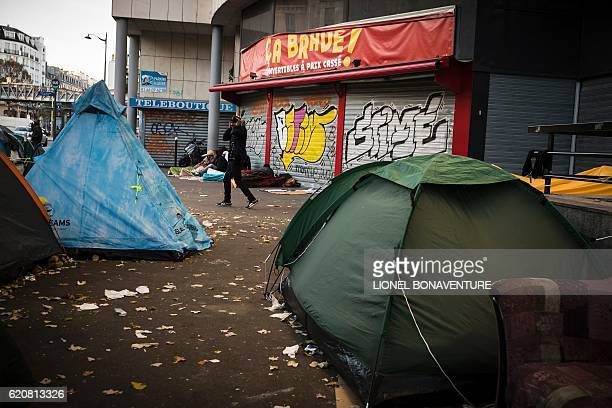 This photo taken on November 3 2016 in Paris shows a migrant tent camp near to the Stalingrad metro station one of several camps sprouting up around...