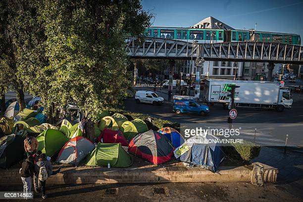 This photo taken on November 3 2016 in Paris shows a migrant tent camp next to the Stalingrad metro station one of several camps sprouting up around...