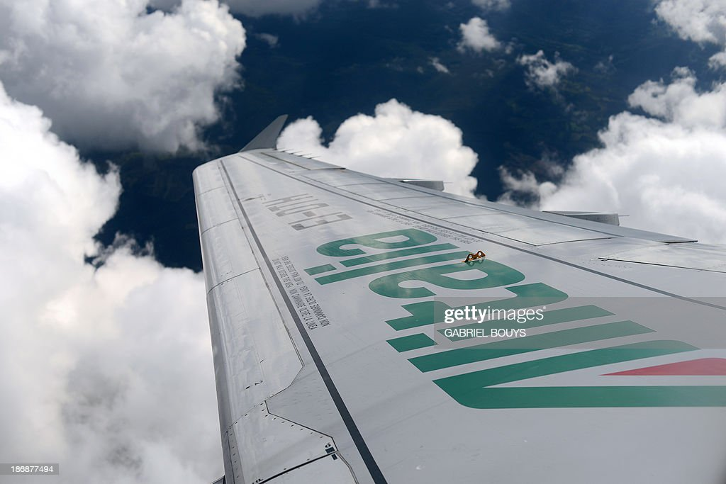 This photo taken on November 4, 2013, shows a wing of an Alitalia airplane. Air France-KLM has laid out conditions for further investment in Italy's troubled Alitalia airline, as Alitalia has been trying to persuade shareholders to inject funds as part of a 300 million euros ($407 million) recapitalisation programme.