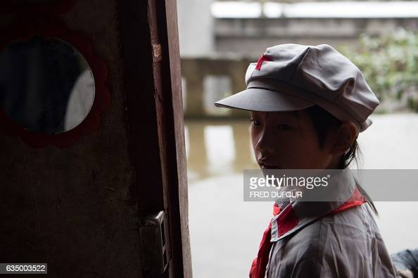 This photo taken on November 7 2016 shows a student arriving home from the Yang Dezhi 'Red Army' elementary school in Wenshui Xishui county Guizhou...