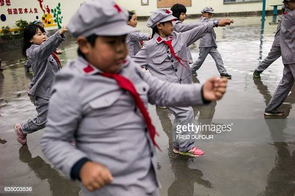 This photo taken on November 7 2016 shows students exercising in the Yang Dezhi 'Red Army' elementary school in Wenshui Xishui country in Guizhou...