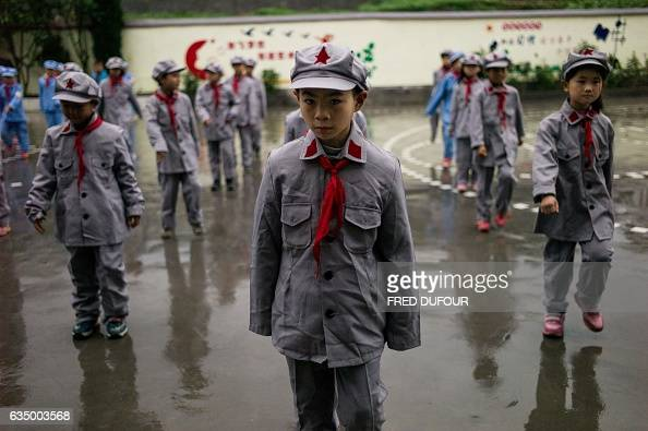 This photo taken on November 7 2016 shows students gathering for the flagraising ceremony at the Yang Dezhi 'Red Army' elementary school in Wenshui...