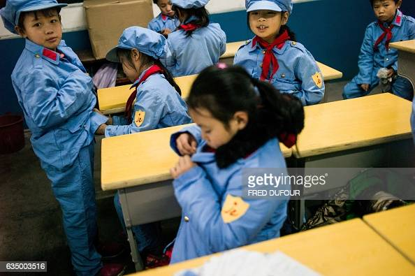 This photo taken on November 7 2016 shows students in a classroom of the Yang Dezhi 'Red Army' elementary school in Wenshui Xishui country in Guizhou...