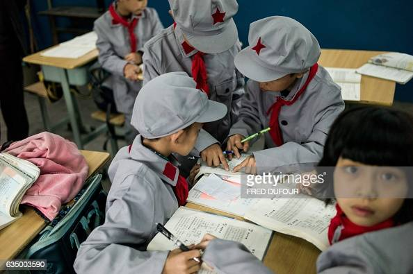 This photo taken on November 7 2016 shows students in their classroom in the Yang Dezhi 'Red Army' elementary school in Wenshui Xishui country in...
