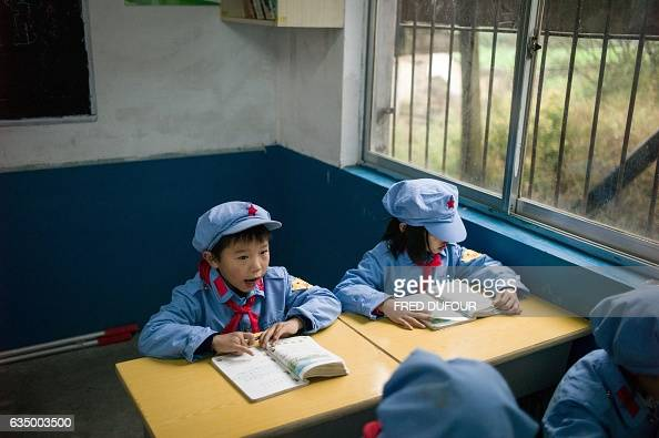 This photo taken on November 7 2016 shows students studying in their classroom in the Yang Dezhi 'Red Army' elementary school in Wenshui Xishui...