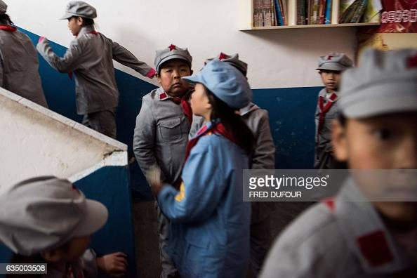 This photo taken on November 7 2016 shows students walking to their classrooms in the Yang Dezhi 'Red Army' elementary school in Wenshui Xishui...
