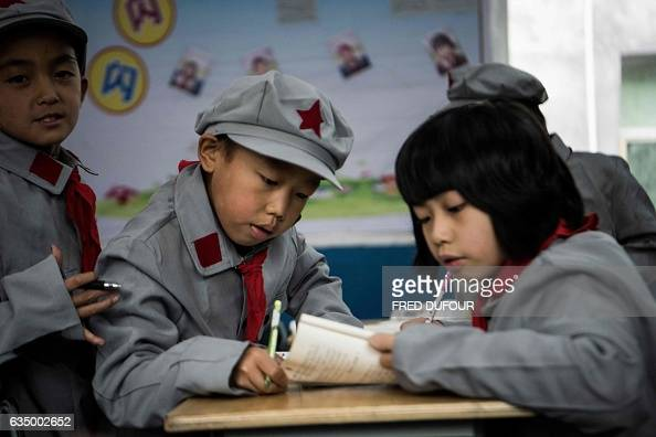 This photo taken on November 7 2016 shows students work in their class at the Yang Dezhi 'Red Army' elementary school in Wenshui Xishui county in...