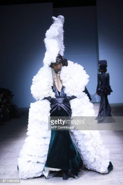 This photo taken on November 7 2017 shows a model parading a creation from the 'Hu Sheguang' collection during China Fashion Week in Beijing / AFP...