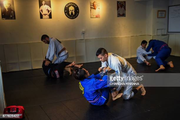 This photo taken on November 7 2017 shows MMA fighter Miao Jie fighting during a training session in Shanghai The 30yearold Shanghai native and...