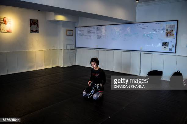 This photo taken on November 7 2017 shows MMA fighter Miao Jie during a training session in Shanghai The 30yearold Shanghai native and single mother...