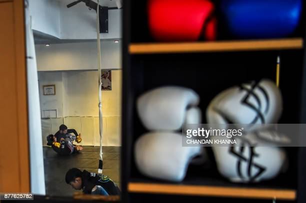 This photo taken on November 7 2017 shows MMA fighter Miao Jie fighting with a trainer during a training session in Shanghai The 30yearold Shanghai...