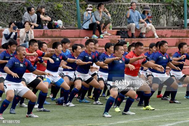 This photo taken on October 1 2017 shows rugby players from the Tokyo Korean Junior and Senior High School performing the haka in the playground of...
