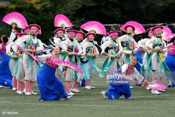 This photo taken on October 1 2017 shows students clad in Korean costumes from the Tokyo Korean Junior and Senior High School performing a...