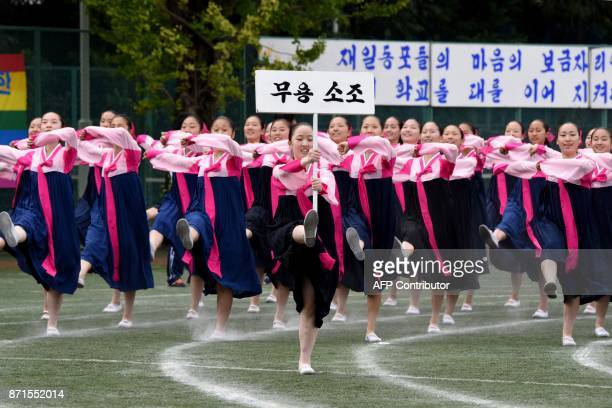 This photo taken on October 1 2017 shows students clad in traditional Korean costumes from the Tokyo Korean Junior and Senior High School marching in...