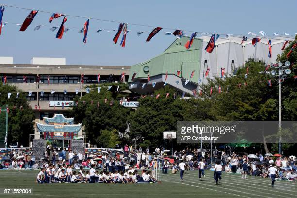 This photo taken on October 1 2017 shows students of the Tokyo Korean Junior and Senior High School taking part in a race under North Korean national...