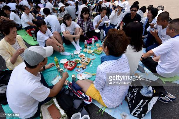 This photo taken on October 1 2017 shows students of the Tokyo Korean Junior and Senior High School and their family members enjoying their lunch in...