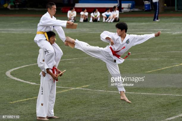 This photo taken on October 1 2017 shows students of the Tokyo Korean Junior and Senior High School performing taekwondo in the playground of the...