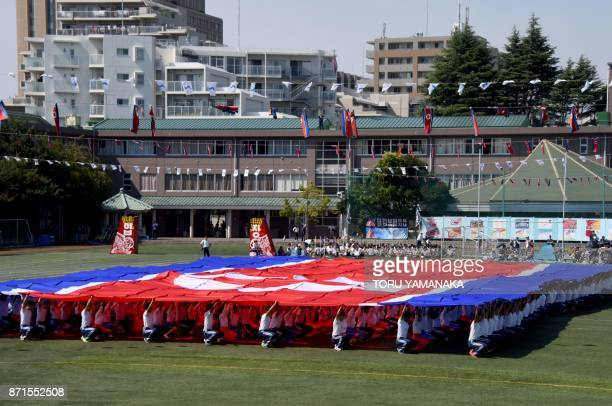This photo taken on October 1 2017 shows students of the Tokyo Korean Junior and Senior High School forming a big North Korean national flag in the...