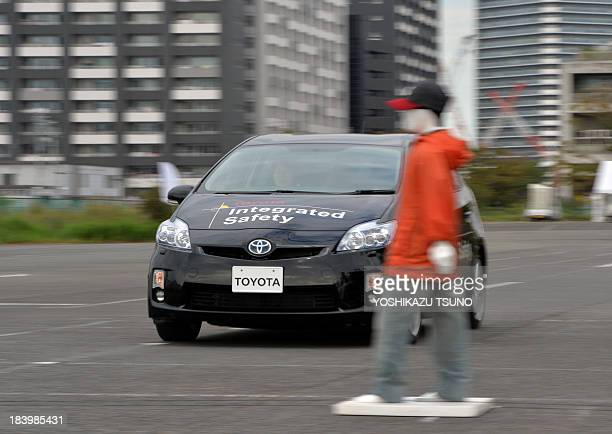 This photo taken on October 10 2013 shows Japanese auto giant Toyota Motor demonstrating its 'precollision system' which uses automatic steering in...