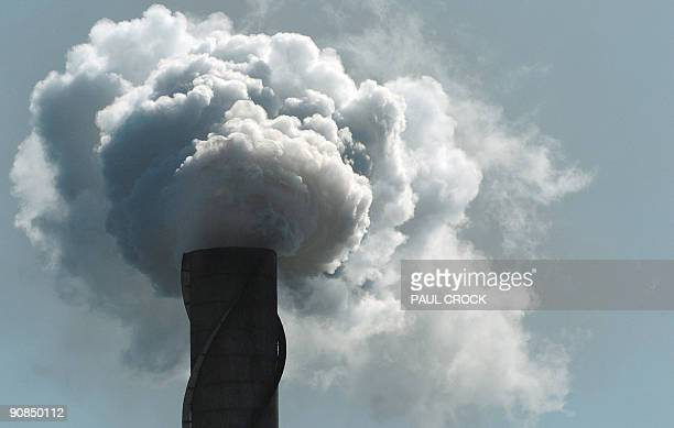 This photo taken on October 12 2006 shows exhaust stacks on a nother Queensland sugar refinery in Ayr pumping plumes of smoke and steam into the air...