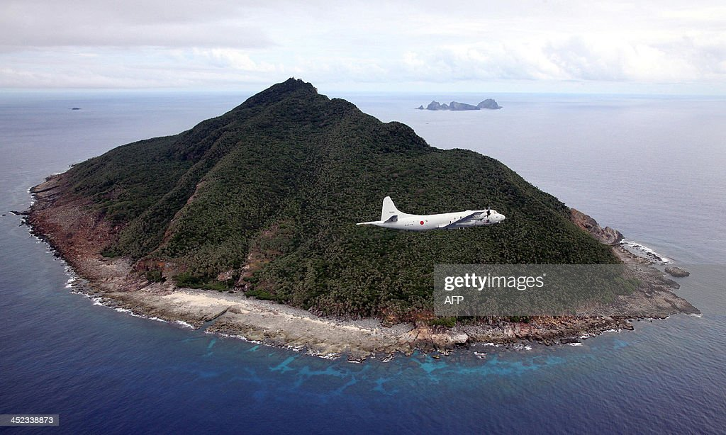 This photo taken on October 13 2011 shows a P3C patrol plane of Japanese Maritime SelfDefense Force flying over the disputed islets known as the...