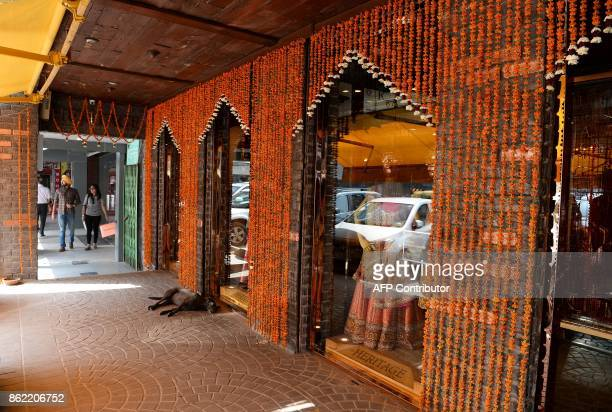 This photo taken on October 15 2017 shows the outside view of a market area in New Delhi This close to India's glittering festive season the cash...