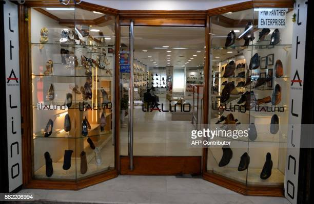 This photo taken on October 15 2017 shows the outside view of a shoe store in New Delhi This close to India's glittering festive season the cash...