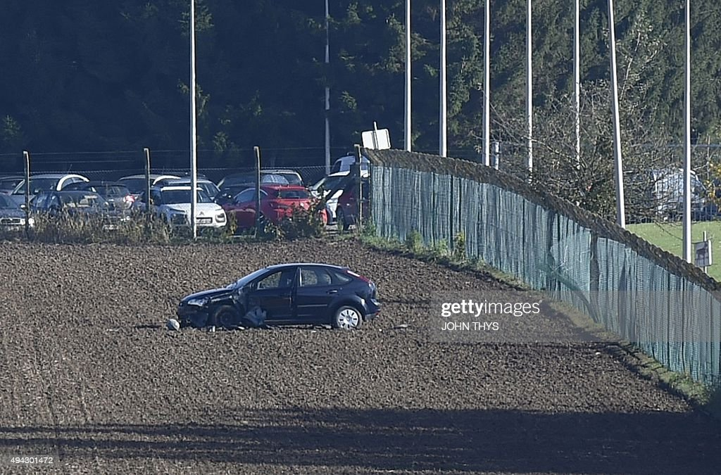 This photo taken on October 26 2015 shows a damaged car at the army barracks in Flawinne Namur Province after a man attempted to drive through the...