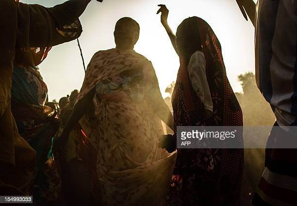 This photo taken on October 29 shows refugees from South Kordofan dancing to traditional songs at the Yida Refugee Camp in South Sudan Yida refugee...