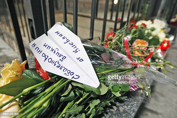 This photo taken on October 31 2015 at the Russian embassy in Kiev shows a paper airplane signed 'Condolences from the people of Kiev' to commemorate...