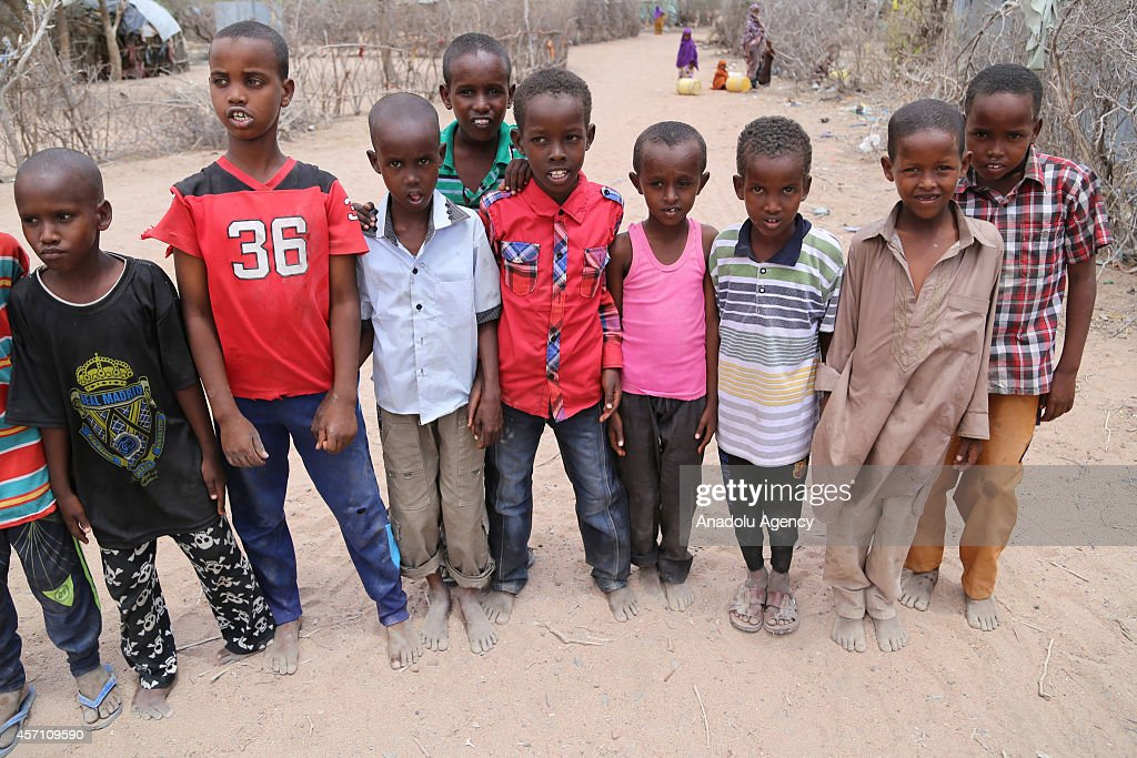 This photo taken on October 4 2014 shows two refugee boys posing at Dadaab refugee camp in Kenya the largest refugee complex in the world where...