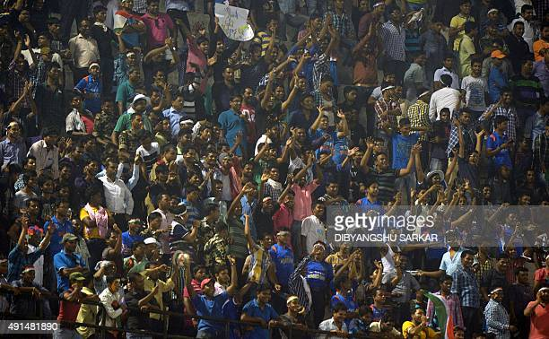 This photo taken on October 5 2015 shows Indian cricket fans as play is interrupted by spectators throwing bottles onto the pitch at the second T20...