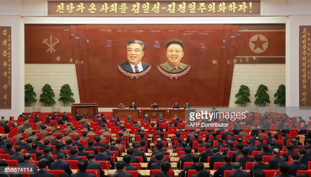 This photo taken on October 7 2017 and released on October 8 2017 by North Korea's official Korean Central News Agency shows North Korean leader Kim...