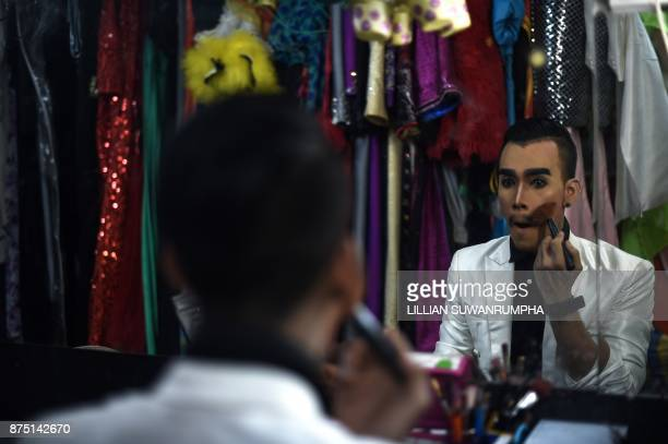 This photo taken on October 7 2017 shows a cabaret performer applying makeup in the dressing room at ZAG bar a gay entertainment venue in Thailand's...