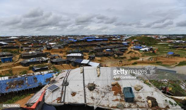 This photo taken on October 7 2017 shows a solar panel on the roof of temporary homes of Rohingya refugees at the Kutupalong refugee camp in Cox's...