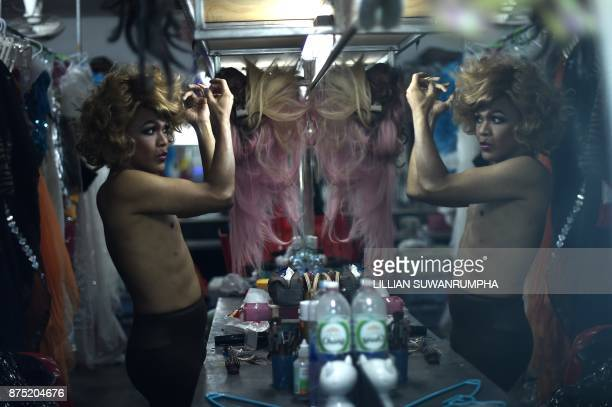 This photo taken on October 7 2017 shows a Thai cabaret performer fixing a wig in the dressing room at ZAG bar a gay entertainment venue in...