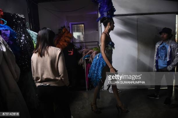 This photo taken on October 7 2017 shows a Thai cabaret performer walking back to the dressing room at ZAG bar a gay entertainment venue in...