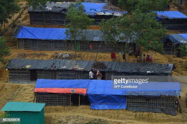 This photo taken on October 7 2017 shows solar panels on roofs of temporary homes of Rohingya refugees at the Kutupalong refugee camp in Cox's Bazar...