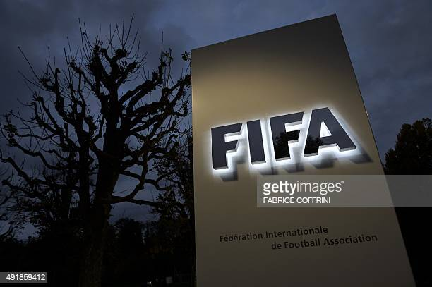 This photo taken on October 8 2015 in Zurich shows the entrance sign with the logo at the FIFA world headquarters FIFA's ethics watchdog on Thursday...