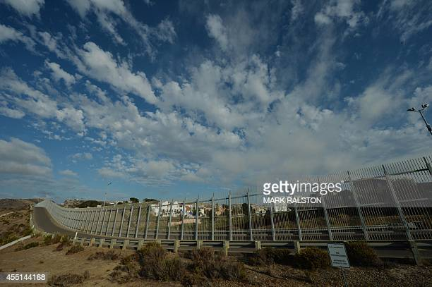 This photo taken on on August 20 shows the border fence that divides the US from Mexico in San Diego California Every year thousands of wouldbe...